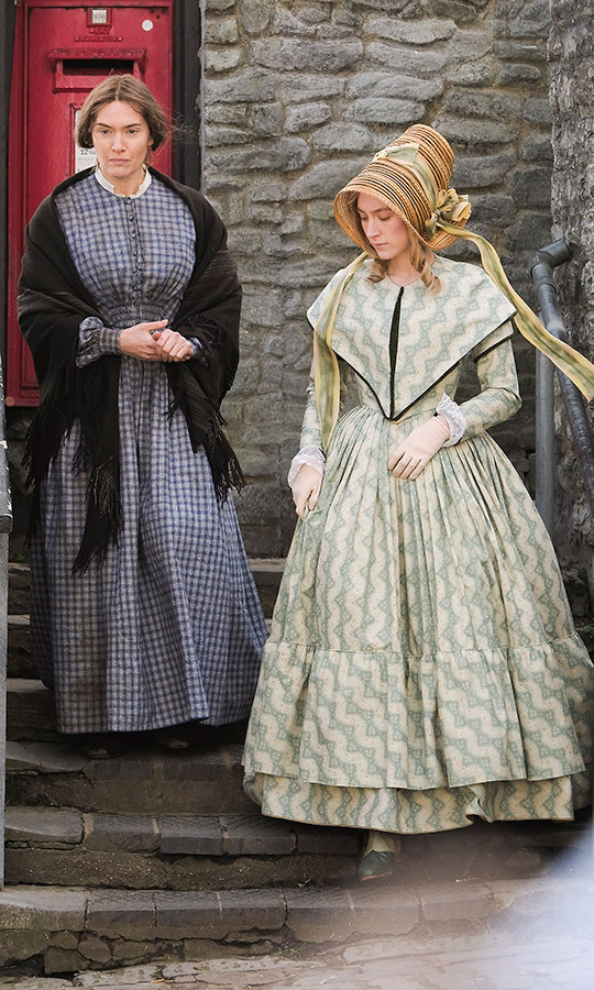 Can you guess who these two are? It's Kate Winslet and Saoirse Ronan! The two were dressed in costume on the set of new period drama <em>Ammonite</em> – which is filming in rural Lyme Regis, England – on March 13.