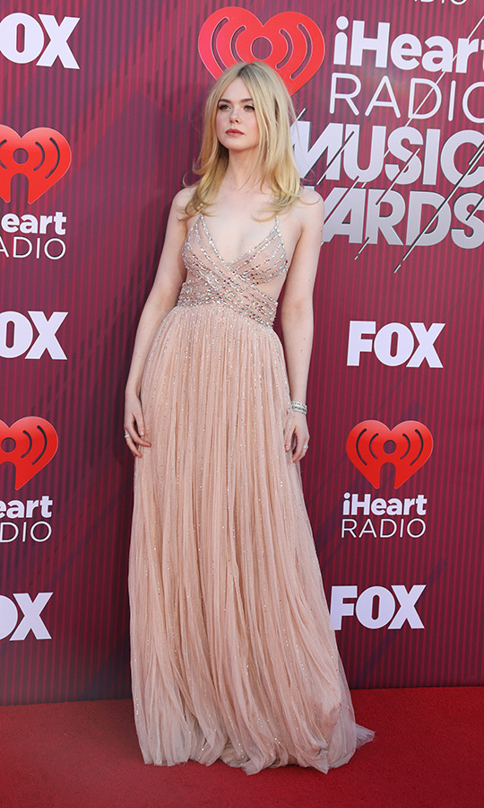 "<strong><a href=""https://ca.hellomagazine.com/tags/0/elle-fanning"">Elle Fanning</strong></a> rocked the red carpet in a sequin-encrusted sheer blush gown. The actress recently made headlines for a clip of her cover of Robyn's ""Dancing on My Own"" that will appear in the upcoming film <em>Teen Spirit</em>.