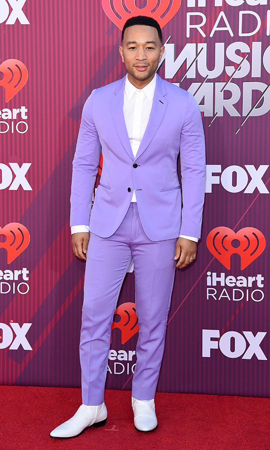 "Powerful in purple! <strong><a href=""https://ca.hellomagazine.com/tags/0/john-legend"">John Legend</a></strong> showed off his colourful style on the red carpet before taking the stage to perform ""Preach."" By then, the EGOT winner had changed into a similar gold-coloured suit.