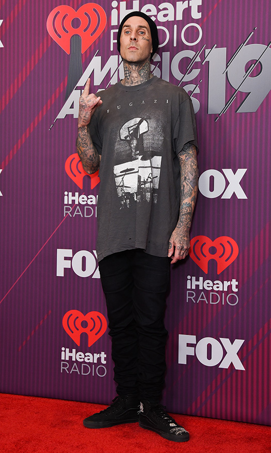 <strong>Blink-182</strong> drummer <strong>Travis Barker</strong> showed off his love for fellow punk icons Fugazi with a simple, dressed-down T-shirt and jeans look. 