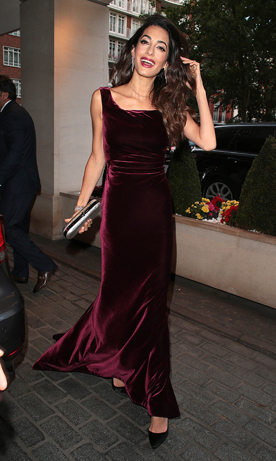 Amal looked stunning in this burgundy velvet gown she was spotted wearing while heading to the WAAAUB UK Chapter Gala Dinner in London.