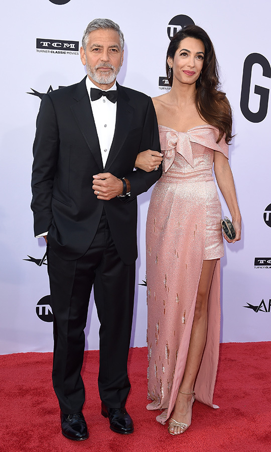Back in June 2018, Amal wowed with a pink Prada gown at the American Film Institute Lifetime Achievement Award event in Los Angeles. She was accompanied by George, who was given the lifetime achievement award. 