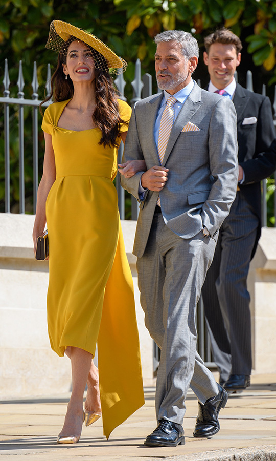 "Who can forget Amal's stunning look at Meghan and <strong><a href=""https://ca.hellomagazine.com/tags/0/prince-harry"">Prince Harry</a></strong>'s wedding in May 2018? She looked breathtaking as the couple arrived at St. George's Chapel at Windsor Castle, wearing a stunning yellow Stella McCartney dress with a matching veiled hat. 