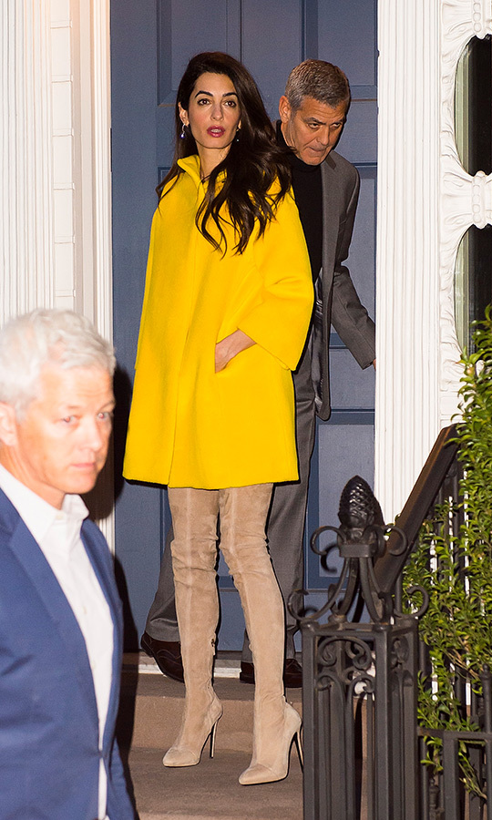 Amal wore this eye-catching yellow coat and boots that go up past her knees while heading out to dinner with George in April 2018.