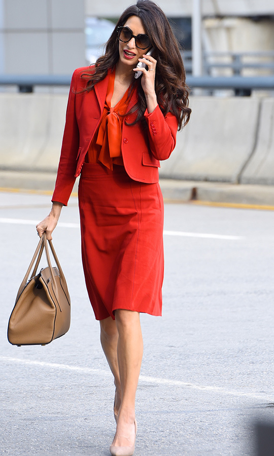 Just three months after welcoming twins <strong>Ella</strong> and <strong>Alexander</strong> with George, Amal was back at work, and was pictured at New York's John F. Kennedy International Airport in this stunning red suit. 