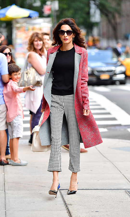 We can't get over the creative contrasts between patterns and styles here! These gingham pants are great enough on their own, but they're really lifted by the pink on this floral coat. Amal was spotted wearing this combination in New York in September 2016. 