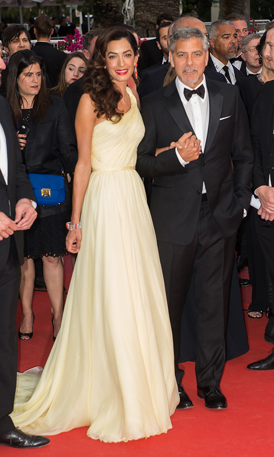 What a dreamy cream-coloured dress for Cannes! Amal wore this yellow chiffon gown at the annual Cannes Film Festival in May 2016 while walking the red carpet with George. 