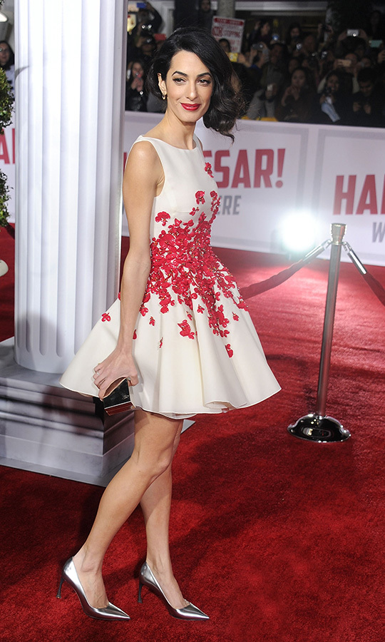 Talk about colour coordination! Amal stepped out for the premiere of George's film <em>Hail Caesar!</em> in Hollywood in February 2016 while wearing this gorgeous dress that was adorned with red flower patterns.