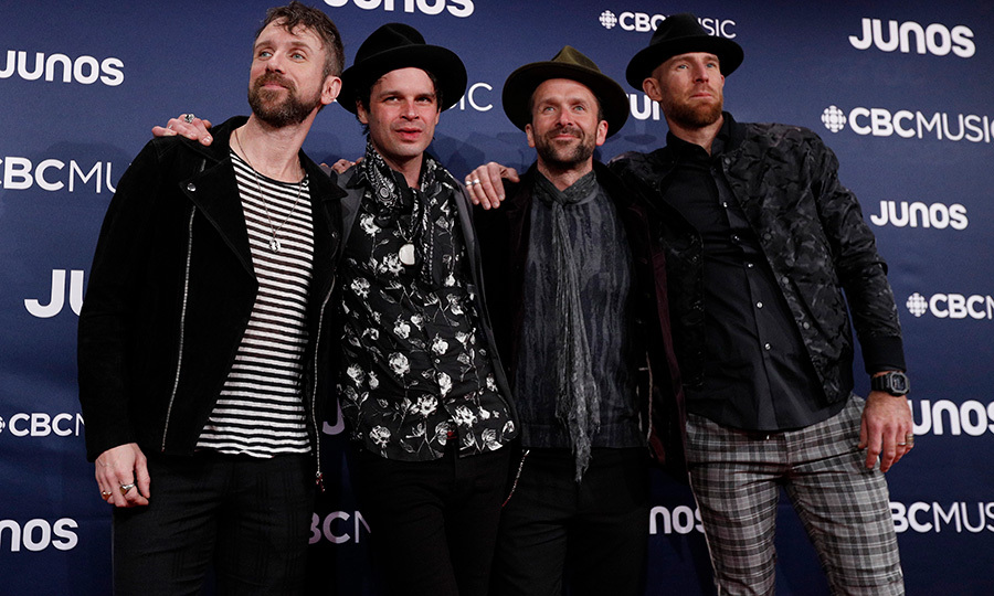 <strong>The Trews</strong> coordinated their red carpet looks with a mix of different black-and-white prints and solid colour, and they also brought their A+ hat game. 