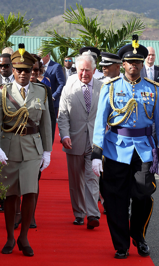 Charles was greeted by an honour guard when arriving at Hewanorra International Airport in Vieux Fort, Saint Lucia, which is located on the southernmost point of the Caribbean island.
