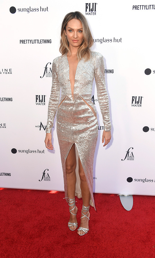 Victoria's Secret Angel <strong>Candice Swanepoel</strong> looked gorgeous in a dazzling metallic gown with matching heels.