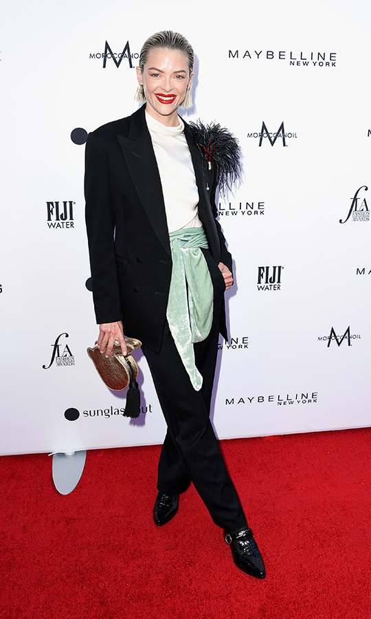 Actress and model <strong>Jaime King</strong> rocked a black suit with tapered pants, a turtleneck and a light green scarf. Her look came complete with feathers on one shoulder.