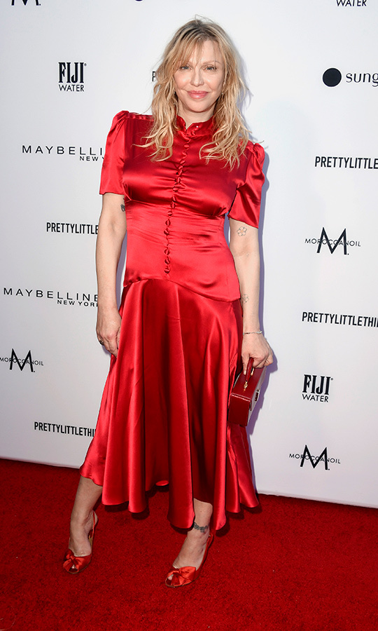 Grunge legend <strong>Courtney Love</strong> wore a look that recalls old Hollywood at the event. Her dress featured a mandarin collar and buttons down its front, and she accessorized with a similar red clutch and heels with bows. 