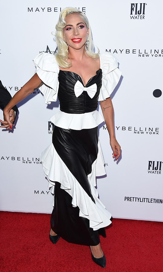 "As is usually the case for her, <strong><a href=""https://ca.hellomagazine.com/tags/0/lady-gaga"">Lady Gaga</strong></a> stepped out in a very creative outfit on March 17. She showed up at Daily Front Row's Los Angeles Fashion Awards in a black-and-white leather Rodarte gown. Mother Monster had also curled her hair, giving her a look that's half '50s Hollywood, half '80s glam punk, and wore simple Giuseppe Zanotti pumps on her feet. She accessorized with heart-shaped earrings and wore crystal makeup. 