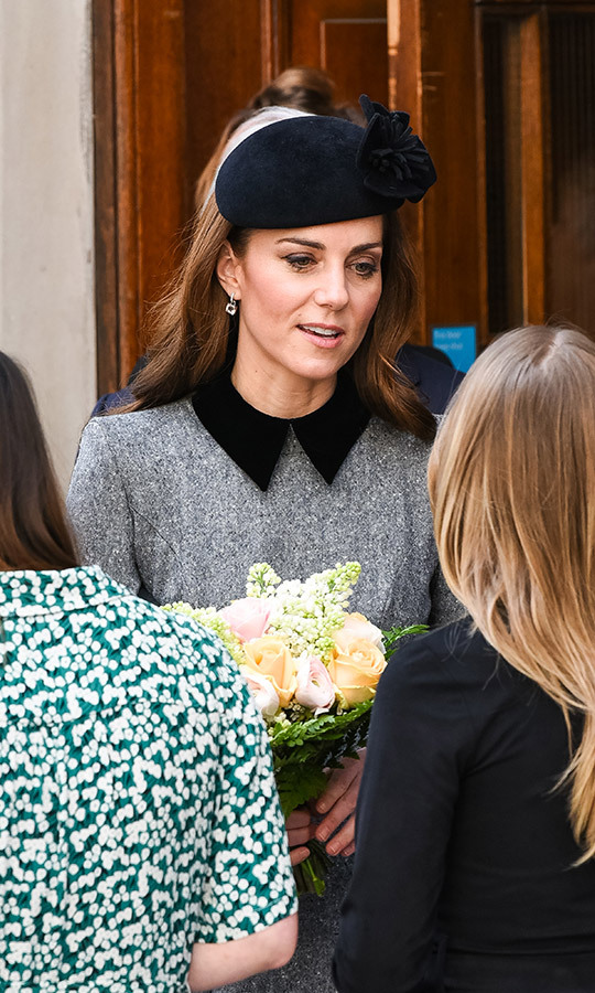 Kate accepted a bouquet from a greeter before heading in to the school.