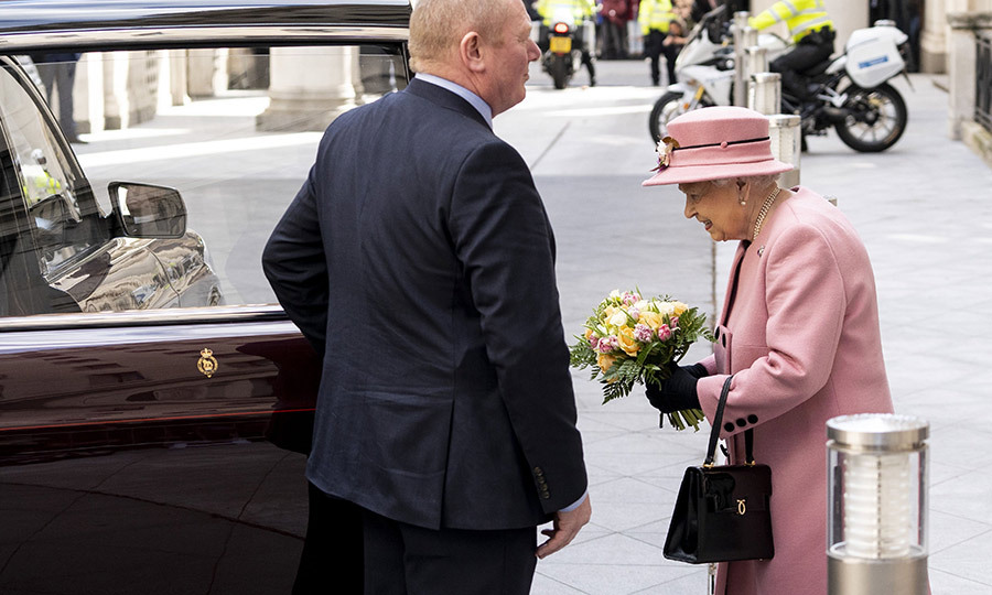 After the tour, the Queen, still carrying the bouquet she was given upon arrival, bid the college farewell. She last visited in 2012. 
