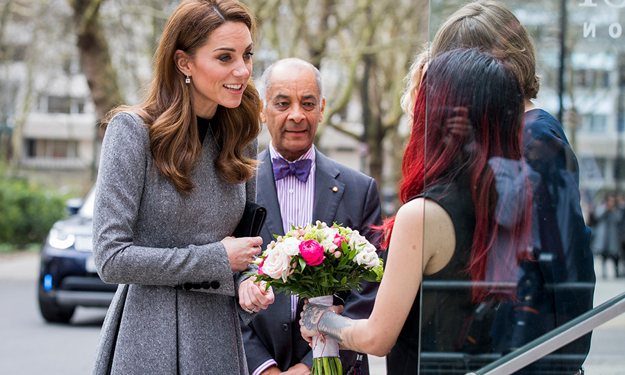 The duchess received another bouquet before heading into the museum.