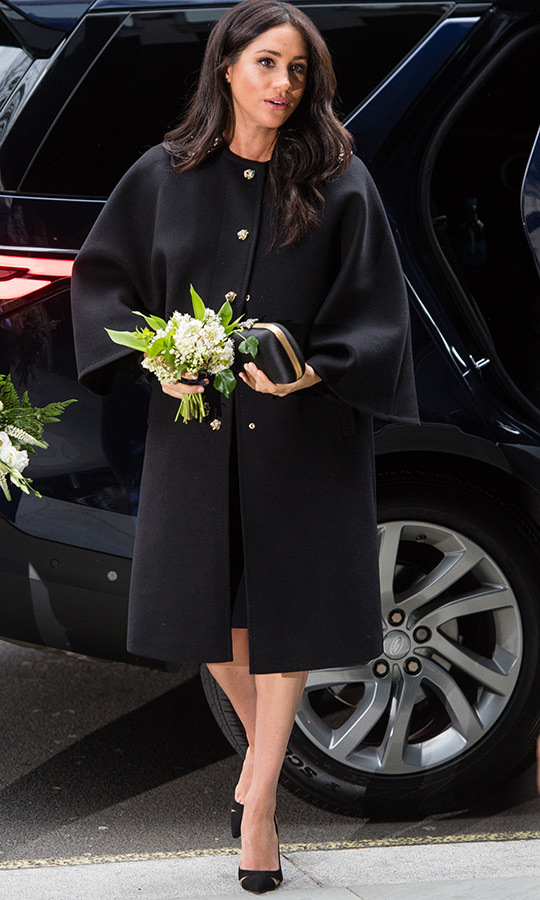 The Duchess of Sussex got out of the royal couple's car carrying a bouquet of white flowers.