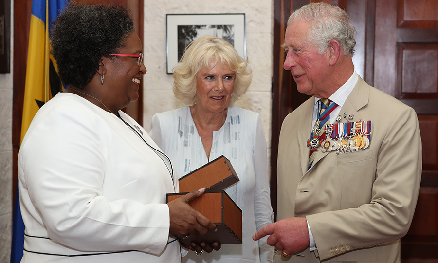 Later, the Duke and Duchess of Cornwall met with Mia again. She presented the royal couple with bottles of local rum. 
