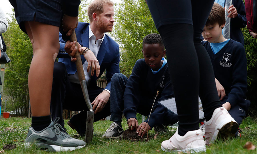 The prince watched while his new friends planted the tree, which was provided by the Woodland Trust, the leading conservation charity in the UK.