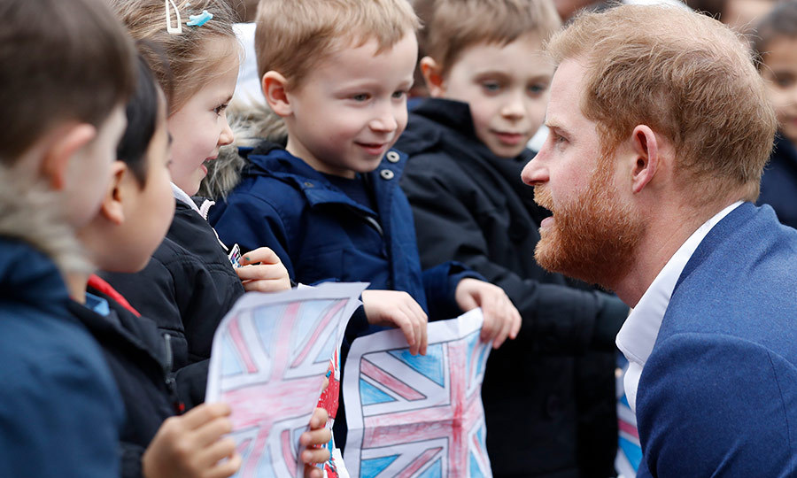 Harry also took time to chat with some students who offered him hand-drawn Union Jacks!