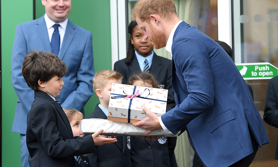 The students also presented Prince Harry with gifts when he was leaving.