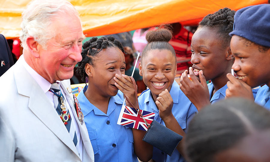 Charles must have said something funny while visiting Kingstown Market!