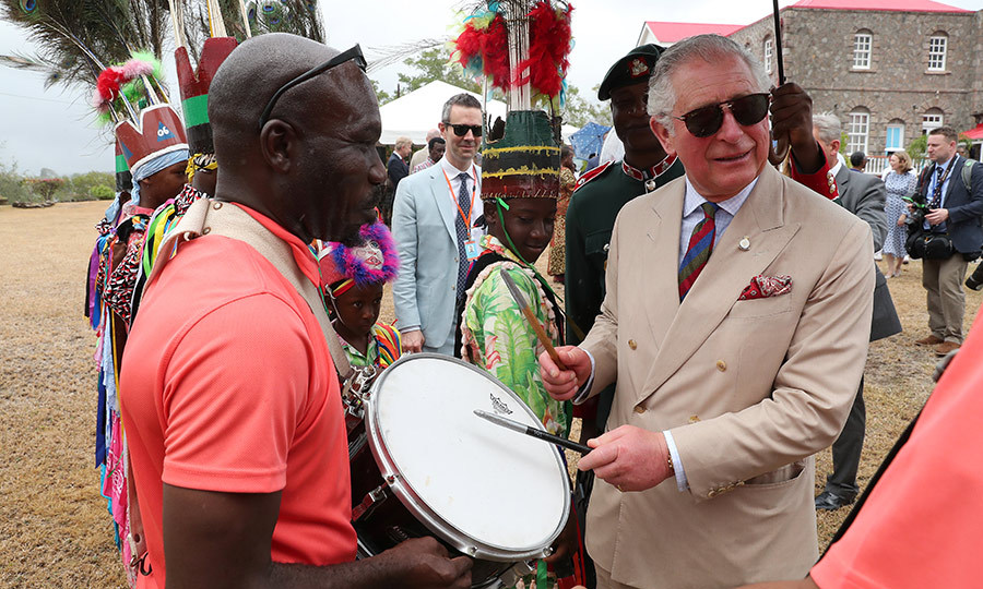 Charles showed off his percussion skills while he and Camilla were given a special reception at the Government House in Nevis. 