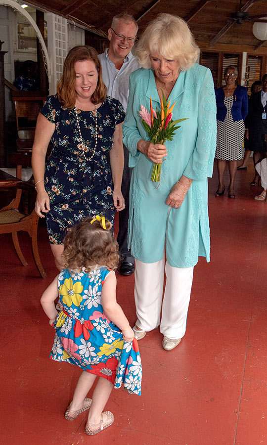 Meanwhile, Camilla received flowers from little Ava Lupinacci, who also danced for her while she visited the Hermitage Plantation House in Nevis. So cute!