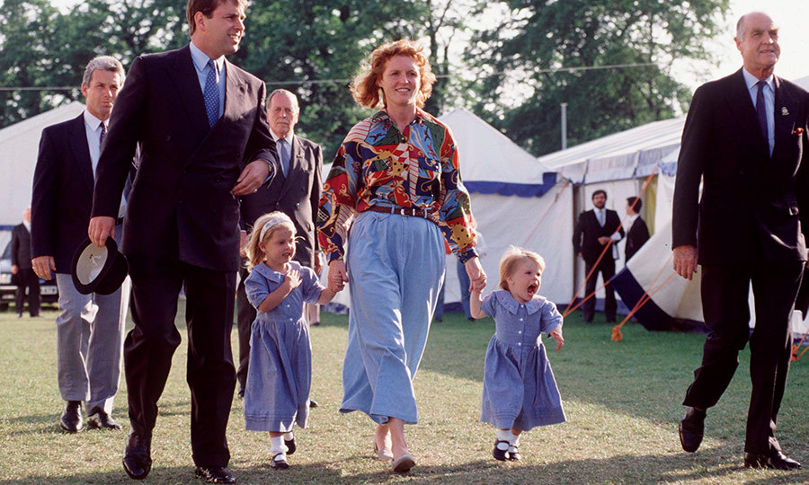 It's hard being two sometimes! Here's a yawning Eugenie (to Sarah's right) and Beatrice wearing matching blue dresses with mom and dad Prince Andrew at the Royal Windsor Horse Show in May 1992.
