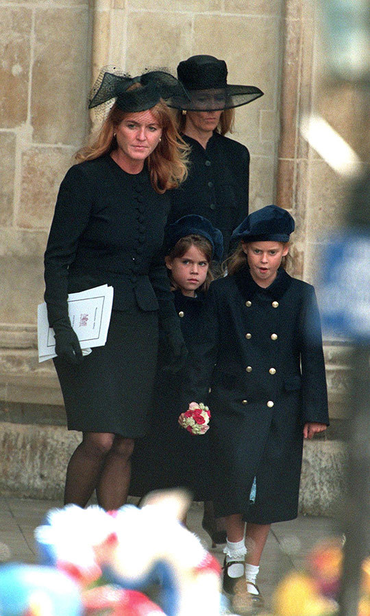 "When she was just seven years old, Eugenie (centre) and Beatrice lost their aunt, <strong><a href=""https://ca.hellomagazine.com/tags/0/princess-diana"">Princess Diana</a></strong>. Here they are leaving the funeral service at Westminster Abbey. When Eugenie was married in 2018, her mom Sarah Ferguson made sure to pay <a href=""https://ca.hellomagazine.com/royalty/2018111164424/how-sarah-ferguson-remembered-princess-diana-at-princess-eugenies-wedding/"">special tribute</a> to Eugenie's aunt. Sarah called Diana her ""best friend."" 