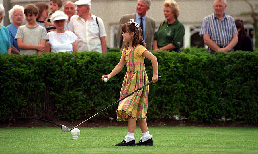 Fore! Here's eight-year-old Eugenie trying her hand at golf during a charity match in Virginia Water, England.