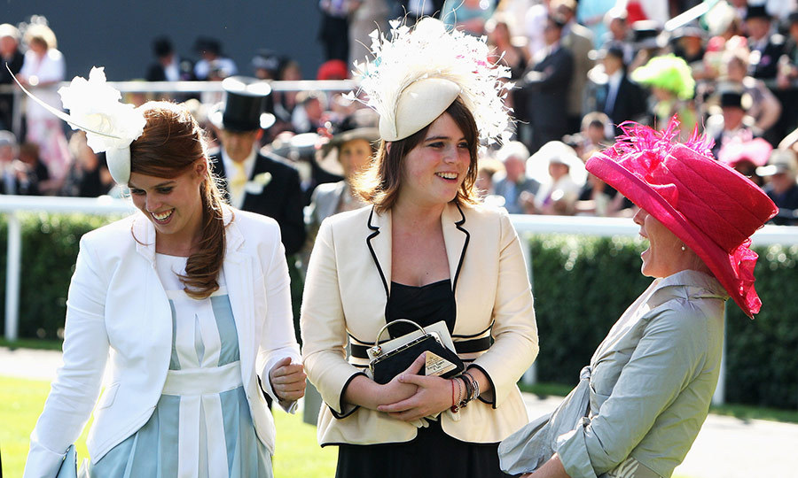 "Something must have been hilarious! <a href=""https://ca.hellomagazine.com/tags/0/autumn-phillips""><strong>Autumn Phillips</a></strong> laughs during the third day of the Royal Ascot with Eugenie (centre) and Beatrice (left) in 2008. 