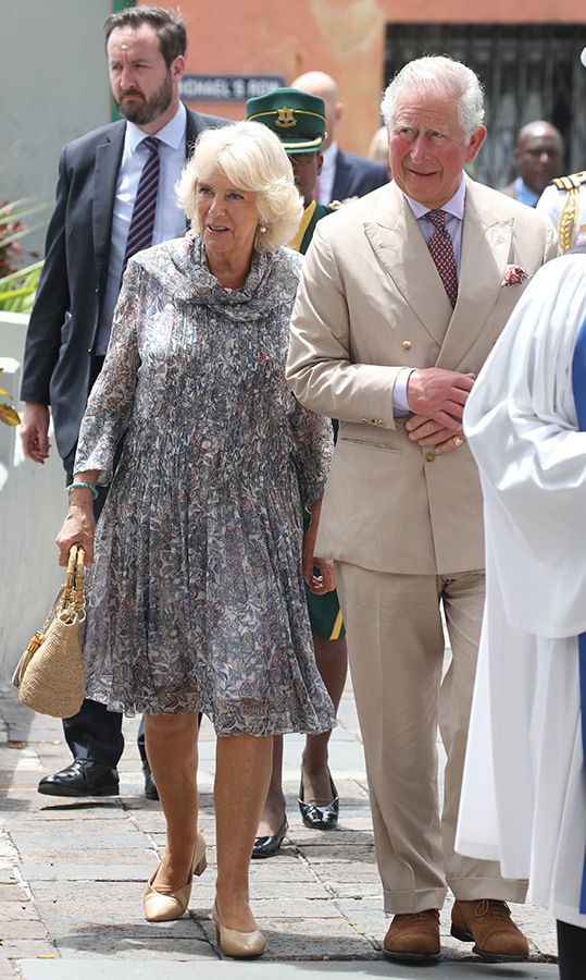 The Duchess of Cornwall dazzled in a floaty floral dress and beige heels. She carried a darling wicker handbag for the sunny day out in Bridgetown.