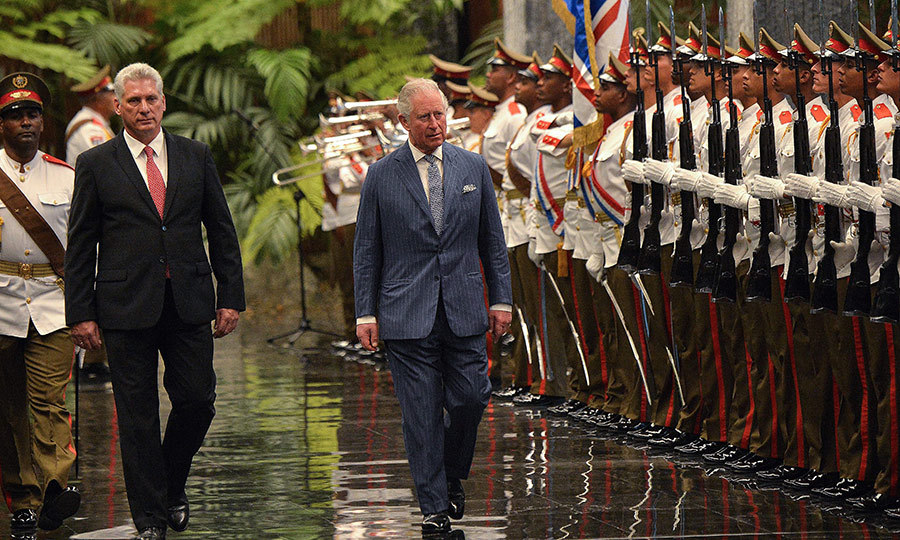 After that it was off to the Palace of the Revolution, where the royal couple got a very special welcome from an hounour guard. The palace is the official residence of Cuba's president, Miguel Diaz-Canel, pictured left. 