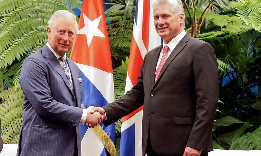 A historic handshake! Prince Charles shakes hands with Cuban President Miguel Diaz-Canel during his visit to the official residence of Cuba's president on Monday (March 25). Charles and Camilla became the first British royals ever to visit the island this week. 