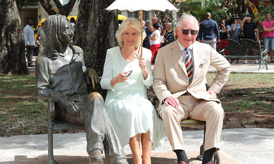 Once they arrived at the venue hosting the event, the royal couple made straight for a bench featuring a sculpture of late Beatle John Lennon! 