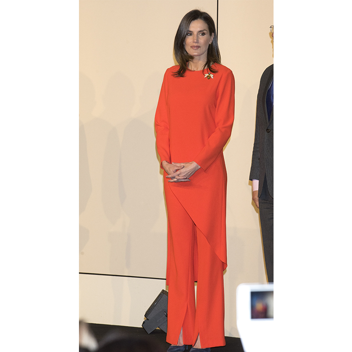 Known for mixing high- and low-end fashion, Queen Letizia stunned in an orange Zara co-ordinating set for day two of her and her husband's visit to Argentina. Contrasting the set with some amazing accessories, the mother-of-two wore her Nina Ricci navy suede pumps and a beautiful bee brooch – a gift from Diminican First Lady, Candida Montilla.