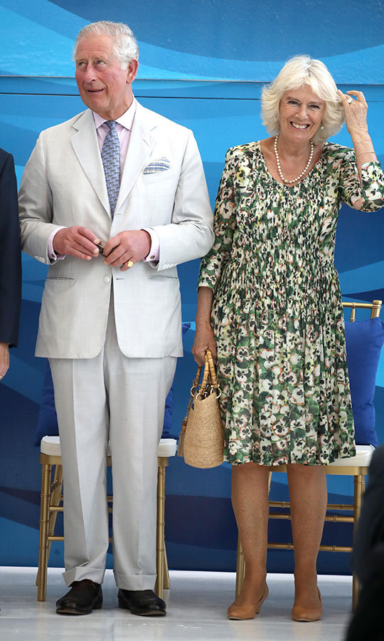 Camilla looked radiant in a beautiful floral dress with nude heels just after the two arrived by plane from Cuba. 