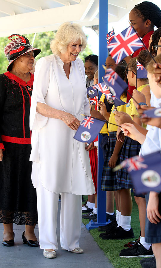 Later in the day, Camilla changed into an all-white outfit for a visit to Georgetown Private School in Grand Cayman. She looked stunning!