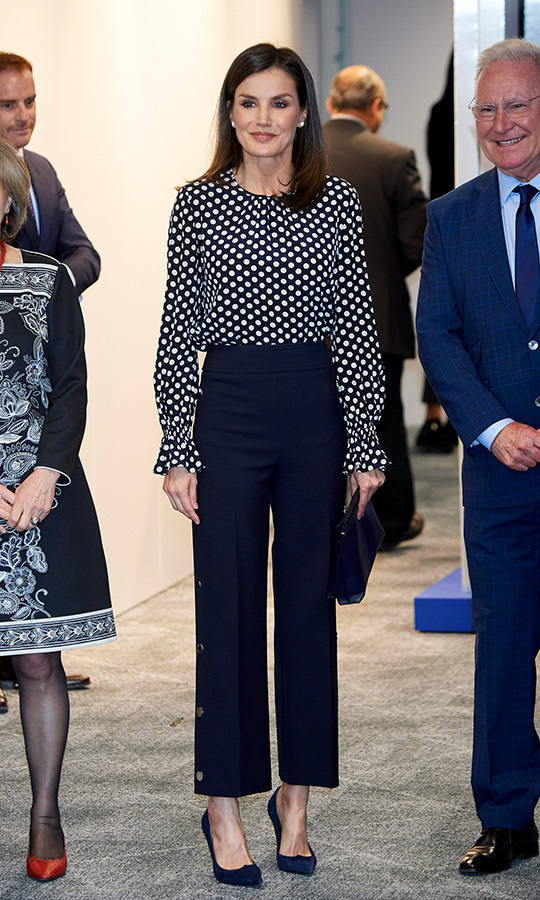 "<A href=""https://ca.hellomagazine.com/tags/0/queen-letizia""><strong>Queen Letizia of Spain</a></strong> was the picture of elegance for a mental health and media event in Madrid on April 3. She dazzled in a black-and-white polka dot blouse, paired with high-waisted button pants and navy blue pumps. <p>Photo: &copy; Carlos R. Alvarez/WireImage"