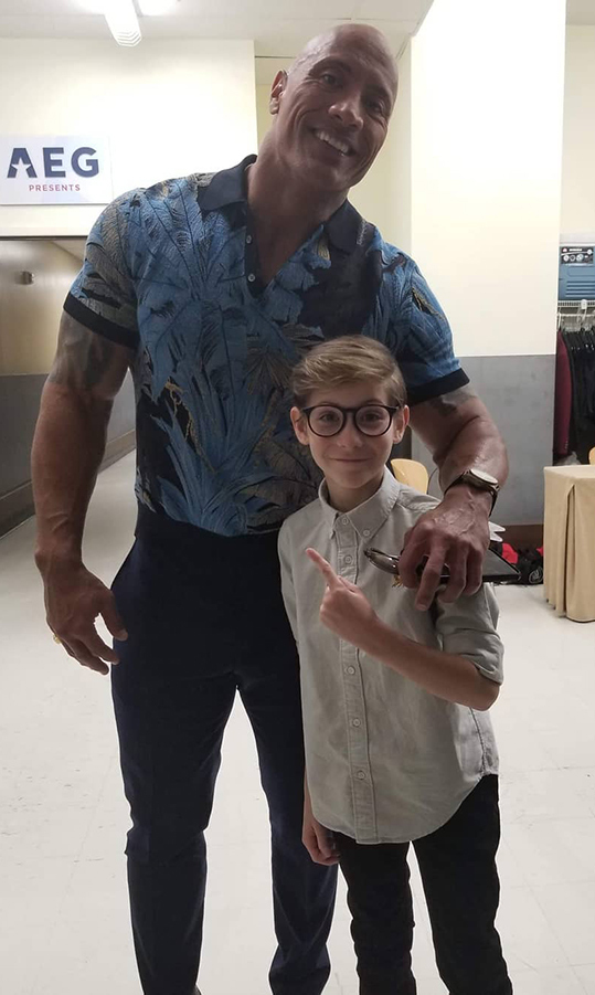 "Jacob had a chance encounter with Dwayne Johnson while they were both in Las Vegas for CinemaCon! The young star captioned the friendly snap: ""Humans in photo are LARGER than they appear!  Thank you Mr. Rock for being so kind & taking the time to chat. ✌""