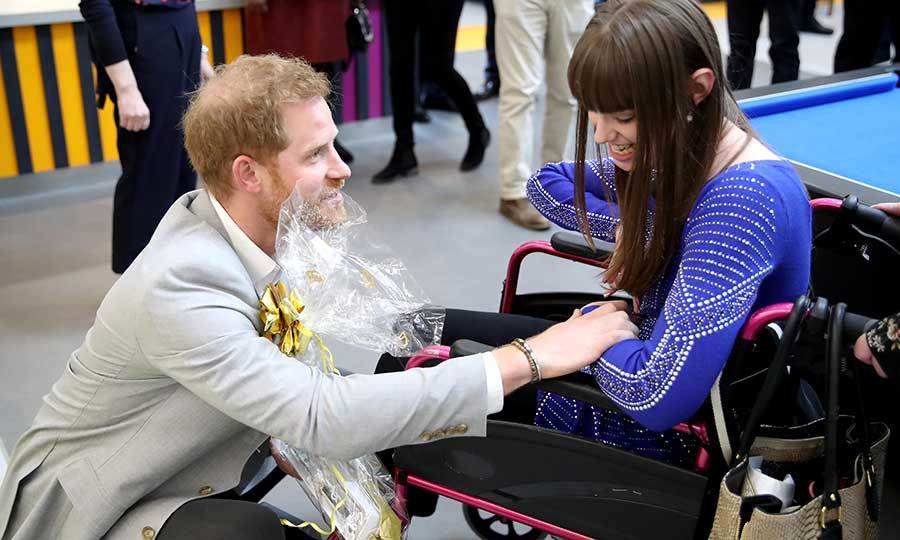 Harry got right down on his knees to talk to a young girl in a wheelchair. Of course, the prince is well known for his work with and advocacy for folks with disabilities, having founded the Invictus Games to help wounded and injured veterans. 