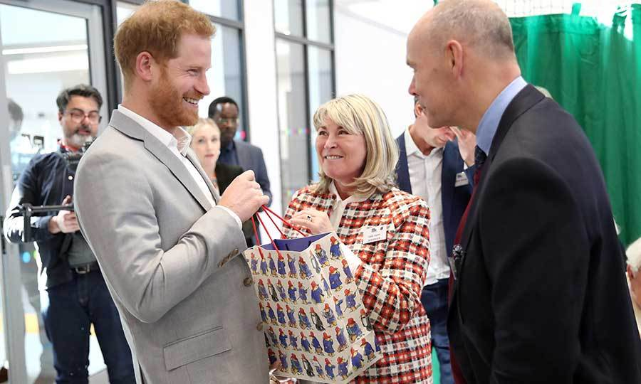 And then he was given some more baby gifts by former Rugby Union player Sir Clive Woodward and his wife Lady Jayne Woodward. Look at that grin!