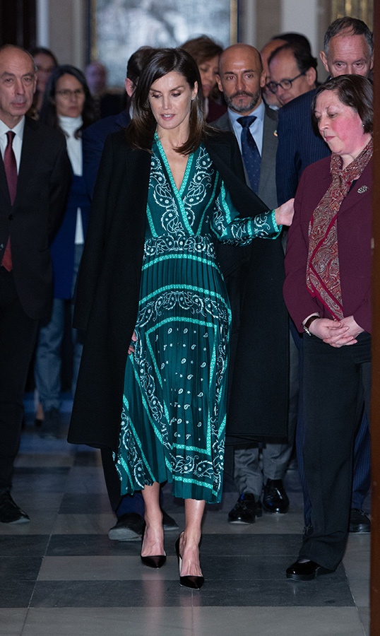 For a visit to the Royal Monastery the day before, the Spanish royal was the picture of cool in a green scarf-print Sandro pleated dress. Draped over her shoulders was her Carolina Herrera A-Line Belted Coat in black, anchored with her Prada Saffiano pumps and her 'Fanila' clutch by Hugo Boss.