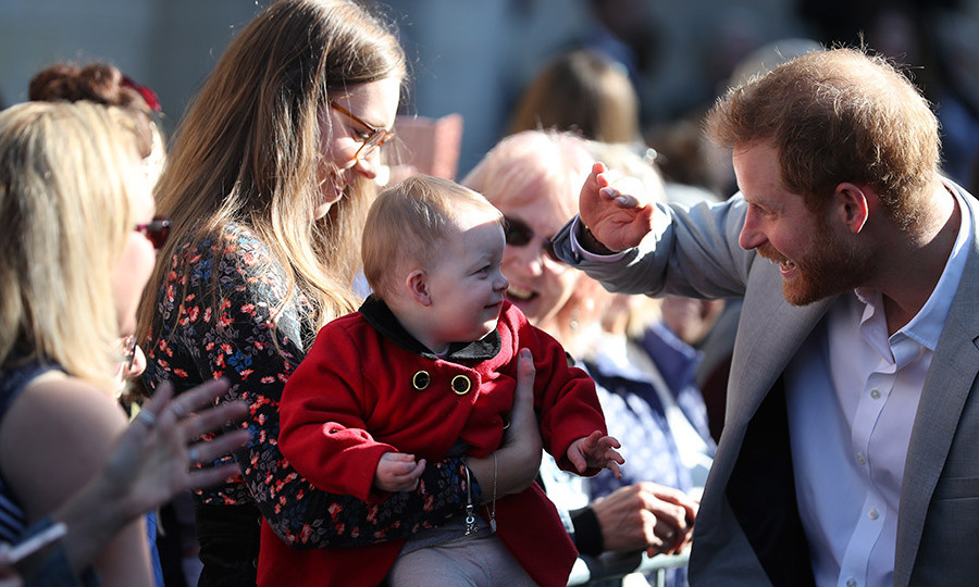 It was a little sunny for this baby! Harry shielded the tot's eyes while chatting with a mom during a walkabout in Sussex, showing off his kind heart.
