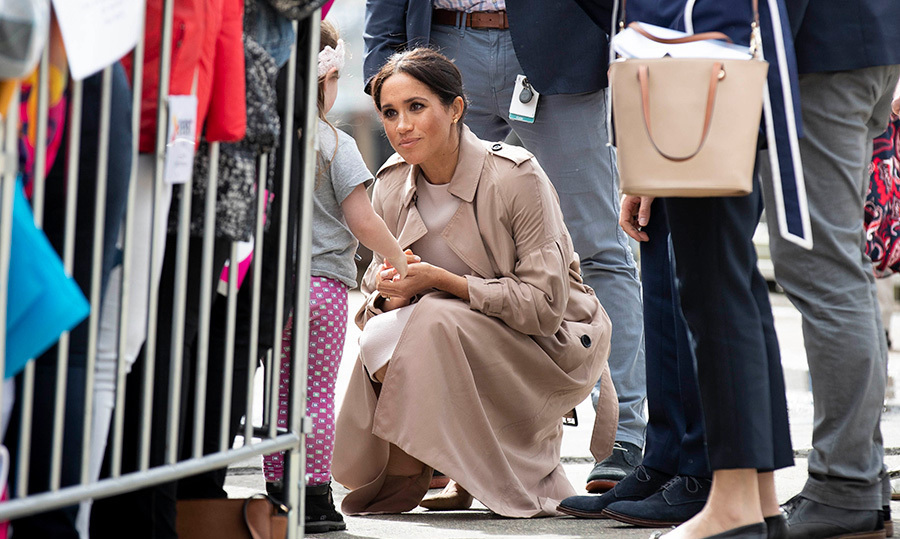 Meghan showed off her maternal side once again while intently listening to a little girl during the walkabout in New Zealand.