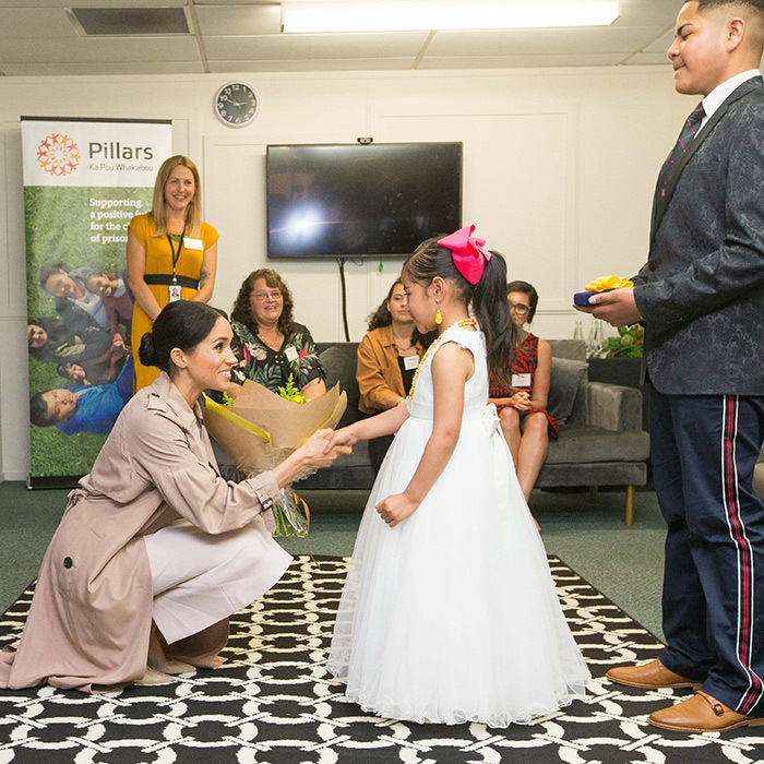 Meghan was also greeted by little Ghianna Orli, who gave the duchess a beautiful bouquet.