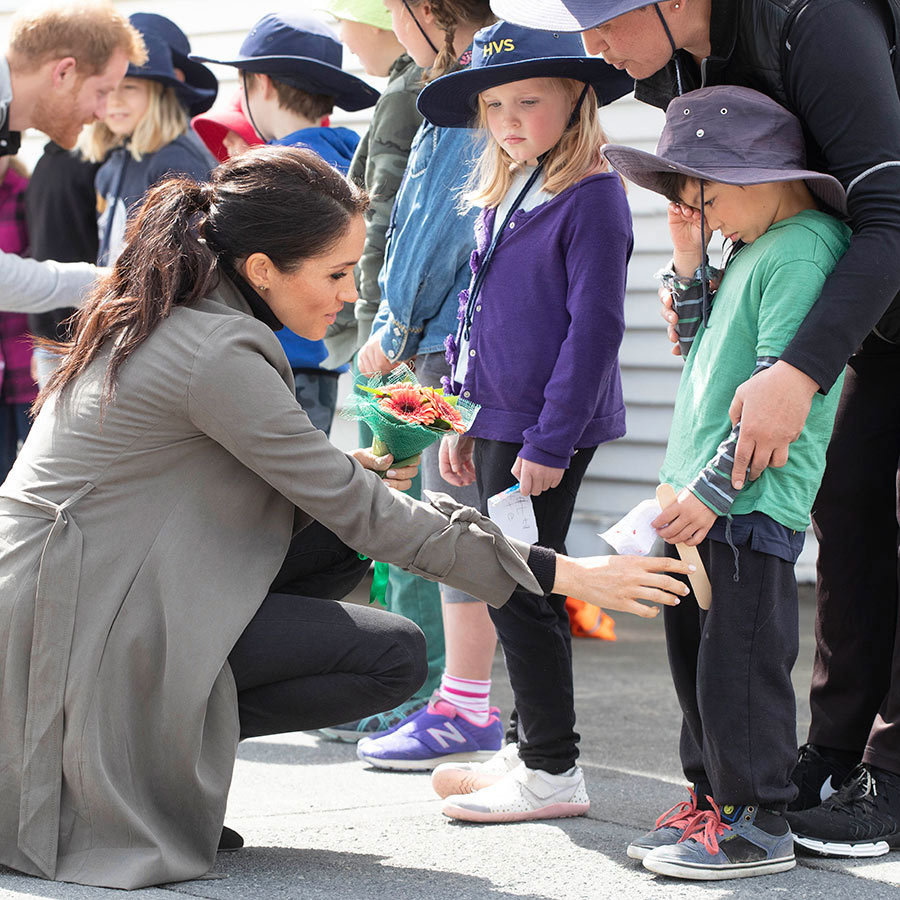 One of the adorable tots, Joe Young, was feeling a bit shy as Prince Harry and Meghan approached him during a walkabout, and the duchess took some time to try to put him at ease.