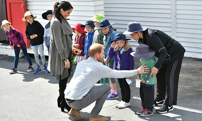 Prince Harry also gave Joe a little tummy tickle to try to cheer him up!